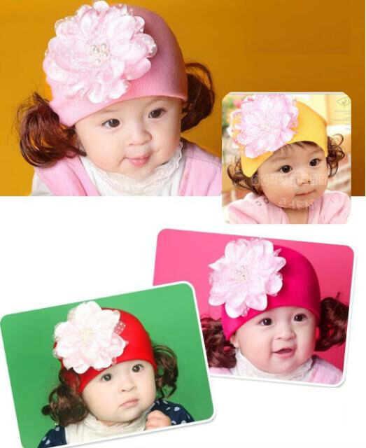 pakaian anak import BEANIE GIRL BIG FLOWER